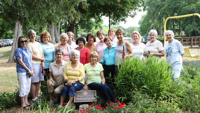 The Fairport Garden Club is celebrating 60 years. Members are pictured at the club's Memorial Garden in Perinton Park.