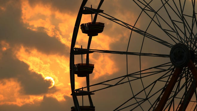 The sun sets on the Great New York State Fair last year.