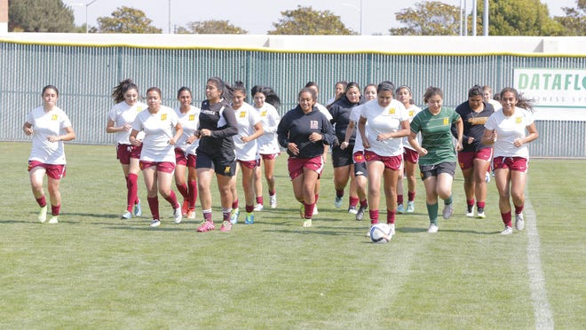 The Hartnell College women's soccer team warms up before a practice last week. The Panthers return their top two scorers from last season.