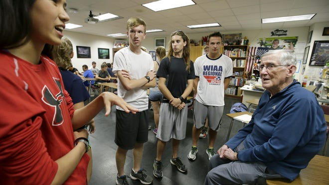 Joe Perez talks with his cross-country athletes before they head out for a long run during practice in September 2016. He coached cross country at Appleton East for 50 years.