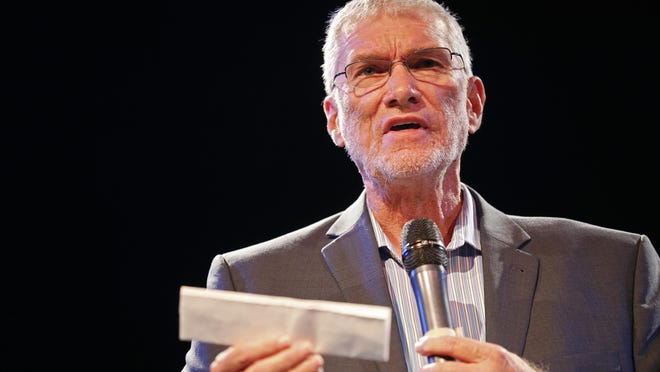 Ken Ham reads a copy of the First Amendment during The Enquirer's One Nation event at Bogart's in the Corryville neighborhood of Cincinnati on Wednesday, Sept. 21, 2016. Ham spoke about the First Amendment and the separation of church and state.