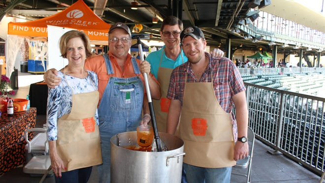 Gail Hankins, Steve Long, Jack Hankins and Ben McNeill Jr. were at Riverwalk Stadium early at a previous cookoff to prepare for their chili cookoff booth.