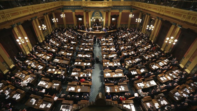 The state Legislature voted Wednesday to pass two ballot proposals that would raise the minimum wage to $12 an hour and require employers to provide paid sick leave for employees. But things aren't as they seem. (Photo: Associated Press)