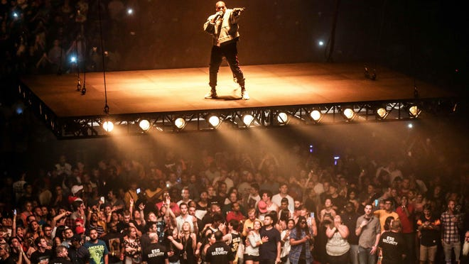 Kanye West makes an entrance on a flying stage for his Saint Pablo Tour.