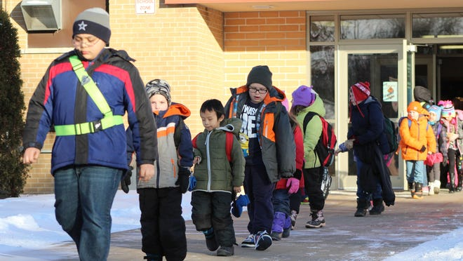 Mead Elementary Charter School students leave the building and head to their buses in this February 2015 photo.