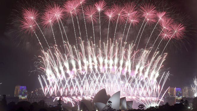 Fireworks explode over the Sydney Opera House and Harbour Bridge as New Year's celebrations are underway in Sydney, Australia, Sunday, Jan. 1, 2017.