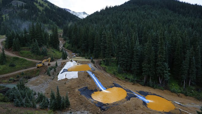 Water flows on Aug. 12, 2015, through a series of retention ponds built to contain and filter out heavy metals and chemicals from the Gold King mine chemical accident outside Silverton, Colo. The massive mine waste spill in southwestern Colorado contributed to water quality problems for up to nine months, the Environmental Protection Agency said Friday. Contamination from the August 2015 spill at the Gold King Mine may also have caused pollution problems last year when annual spring snowmelt swelled rivers.