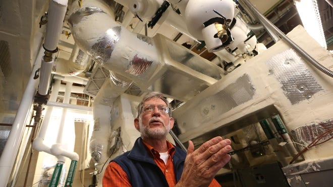 William Sheftall, an extension agent for natural resources, stands in the geothermal HVAC mechanical room while talking about the building's sustainability at the Award-winning, energy-exporting Sustainable Demonstration Center for Leon County government, the UF IFAS Extension Center.