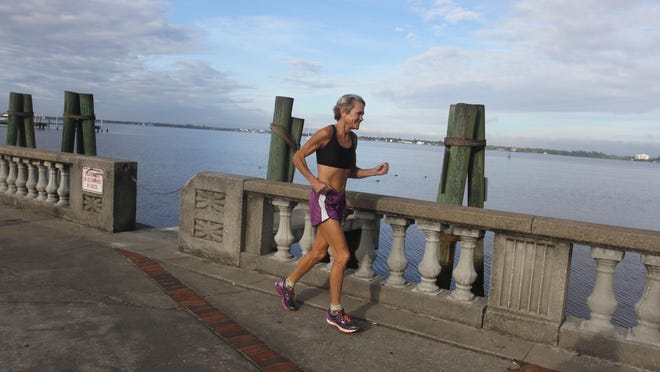 Karen Miles, one of the top 60-64-year-old runners in the country, runs through Centennial Park in a January 2015 training session for the Naples Daily News Half Marathon. Miles will again compete in the race Sunday.
