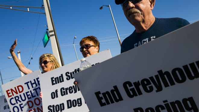 A group of GREY2K USA Worldwide volunteers protest outside of the Naples-Ft. Myers Greyhound Race Track in Bonita Springs on Saturday.