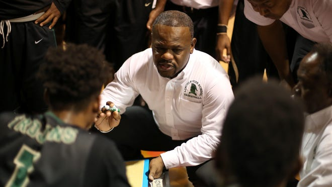 Lincoln boys basketball coach Dimitric Salters talks to his team during a timeout in their game against Leon this season. Salters was suspended by Leon County Schools this week while an investigation takes place into financial concerns raised by parents.