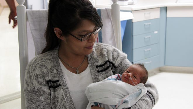 Anganette Encinas with her 11-day-old son Julien in the Kaweah Delta Medical Center NICU.