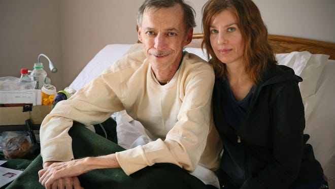 Bob Breitenbach at home with his wife, Ann. Breitenbach, 63, has a debilitating lung illness that has made it impossible for him to work. He is deeply grateful for the kindness and help from his former employer and co-workers.