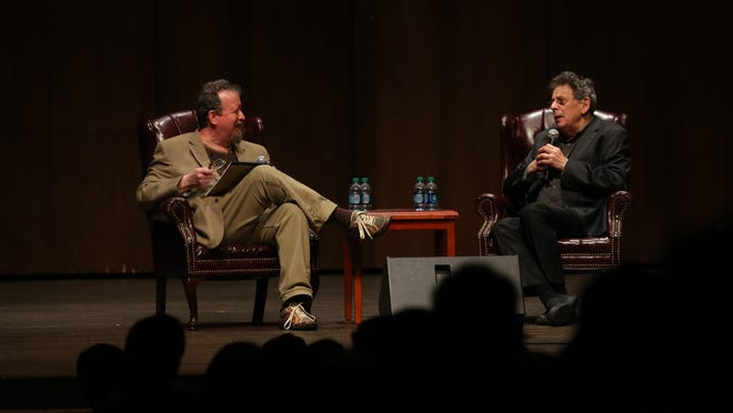 """Tallahassee Democrat arts writer and columnist Mark Hinson, left, interviews composer Philip Glass during """"An Evening With Philip Glass"""" this week at Florida State."""