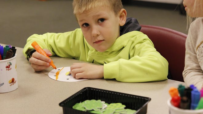 Myles Matzen participates in an activity at the Pleasant Hill library after storytime.
