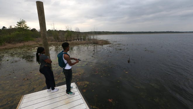 Corneshia Davis, left, and Traâshon Evans fish at Jackson View Landing on Lake Jackson, which officially opened in March, with new parking, a restroom facility, an aluminum floating dock, space for boat trailers, and a rehabilitated boat ramp.