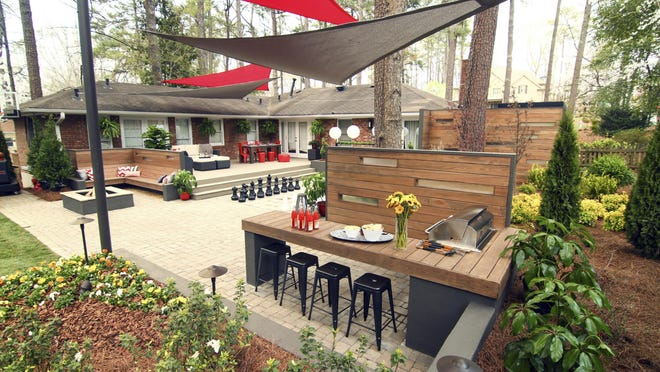 In Buckhead, Ga., Chip Wade incorporated a multi-use rec space with a central court style hardscape. The paver area doubles as entertaining and game space, and the basketball court has a motorized goal.