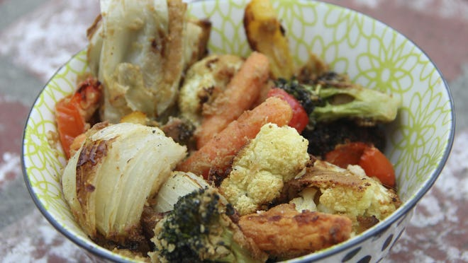 The keys to hummus-crusted roasted veggies are to preheat the baking sheet and to roast at high heat.