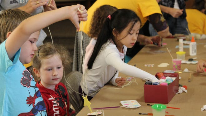 Kids make crafts at last year's vacation Bible school at Sunnyslope Christian Reformed Church, which will return June 26-30. It's one of several vacation Bible schools happening in the Salem area this summer.