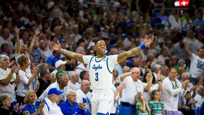 Florida Gulf Coast University sophomore, Rayjon Tucker, #3, pumps up the crowd after scoring during the ASUN Championship Final against the University of North Florida at Alico Arena in Estero, Florida on Sunday, March 5, 2017. The Eagles defeated the Ospreys 77-61.
