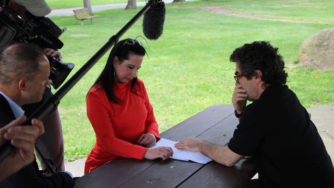 """Joe Berlinger and Angela Clemente talk during the filming of """"Gone: The Forgotten Women of Ohio."""""""