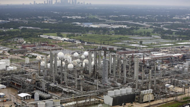 ADDS NAME OF CHEMICAL PLANT - This aerial photo shows the TPC petrochemical plant near downtown Houston, background, on Tuesday, Aug. 29, 2017. (AP Photo/David J. Phillip)