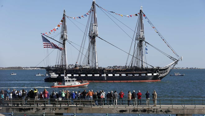 The USS Constitution arrives at Castle Island for a 21-gun salute, Friday, Oct. 20, 2017, in Boston.