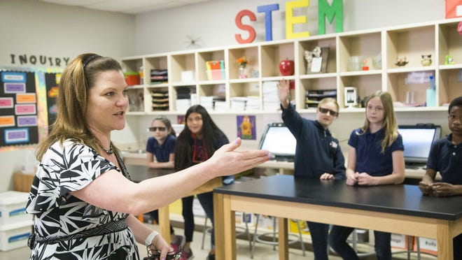 Science teacher Joanna Hughes walks around her classroom in Chandler. Credit: Nick Oza/The Arizona Republic