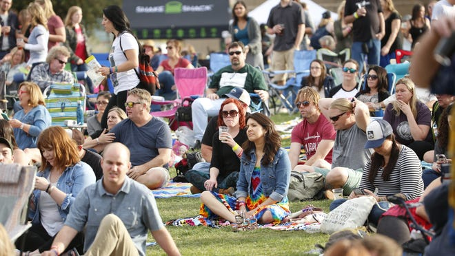 People gather to listen to Railroad Earth at the McDowell Mountain Music Festival on March 5, 2017 in Phoenix, Ariz. Credit: Patrick Breen/The Arizona Republic