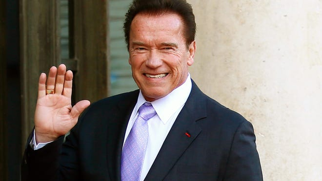 In this Dec. 12, 2017 file photo, Arnold Schwarzenegger waves as he arrives at the Elysee Palace prior to a meeting on climate change in Paris. Schwarzenegger is recovering in a Los Angeles hospital after undergoing heart surgery. He had a scheduled procedure to replace a pulmonic valve on Thursday, March 29, 2018, according to Schwarzenegger's spokesman. He is in stable condition.