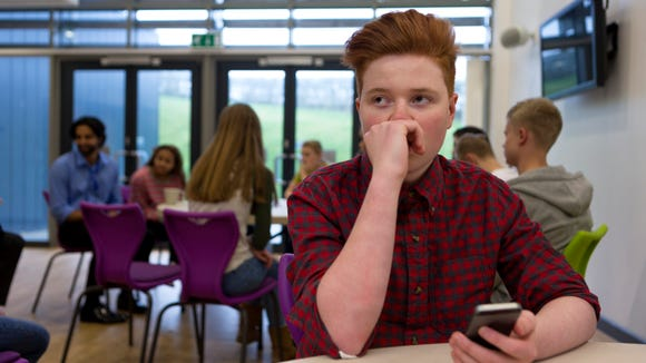 Stressed Student with Smartphone