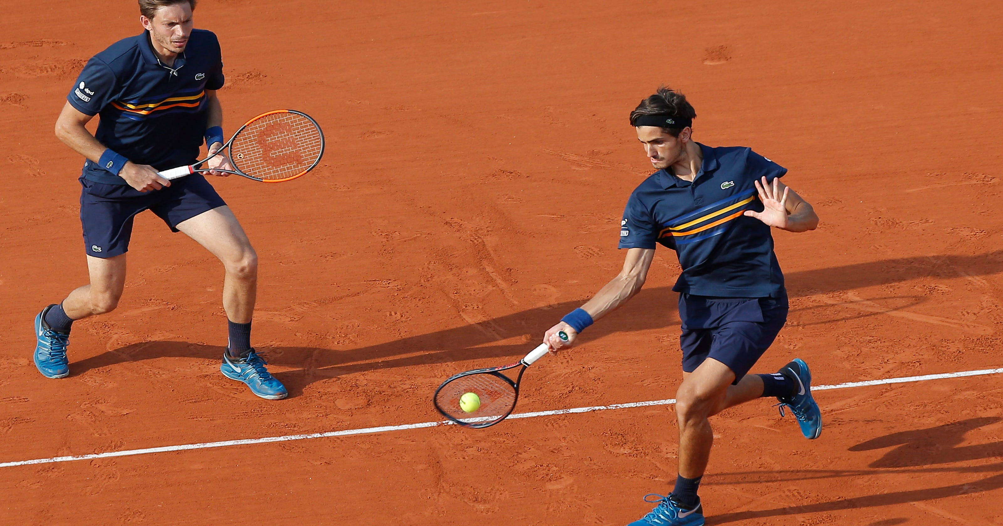 The Latest: French duo Mahut-Herbert win men's doubles title