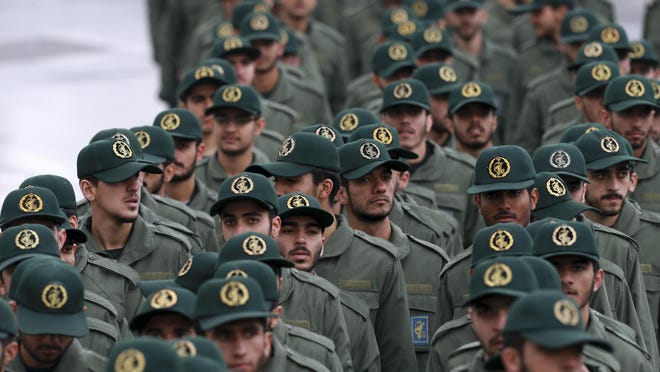 """In this Feb, 11, 2019 file photo, Iranian Revolutionary Guard members arrive for a ceremony at the Azadi, or Freedom, Square, in Tehran, Iran. President Donald Trump's administration is preparing to designate the Revolutionary Guard as a """"foreign terrorist organization."""" It's an unprecedented move that could have widespread implications for U.S. personnel and policy in the Mideast and elsewhere. U.S. officials say an announcement is expected Monday."""