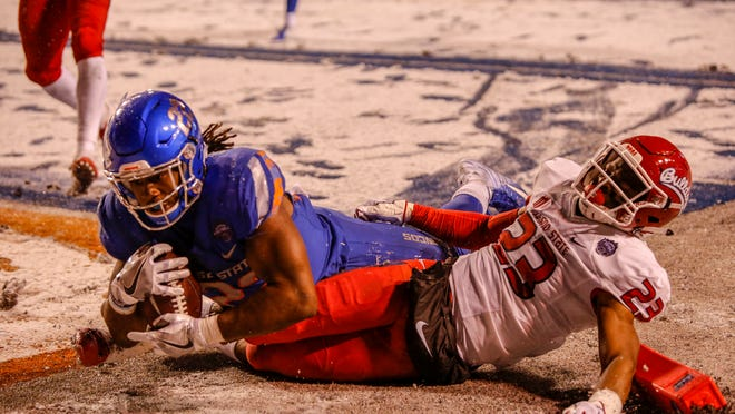 Boise State running back Alexander Mattison (22) slides into the end zone to score against Fresno State defensive back Juju Hughes during last season's Mountain West championship game.