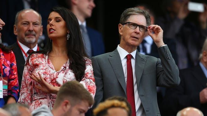 Liverpool owner John W Henry, right, watches his team during the English Premier League soccer match between Liverpool and Norwich City at Anfield in Liverpool, England, Friday, Aug. 9, 2019. (AP Photo/Dave Thompson)
