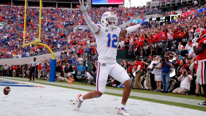 Oct 27, 2018; Jacksonville, FL, USA; Florida Gators defensive back C.J. McWilliams (12) breaks up a pass during the first half at TIAA Bank Field. Mandatory Credit: Kim Klement-USA TODAY Sports