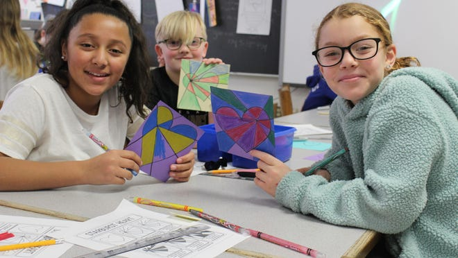 The cards incorporate lessons from both art and library class, and it's a project that sparks excitement and enthusiasm in many students.