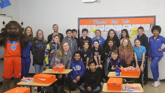 """Madill Middle School algebra teacher Kyle Bare and his class pose together with """"Rumble the Bison"""" and cheerleaders from the Oklahoma City Thunder Monday morning after being announced as monthly winners of the OKC Thunder StatLab contest."""