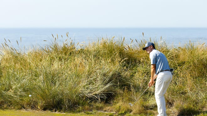 Charles Osborne plays his second shot at the sixth hole during the semifinals Saturday at the U.S. Amateur at Bandon Dunes Golf Resort.