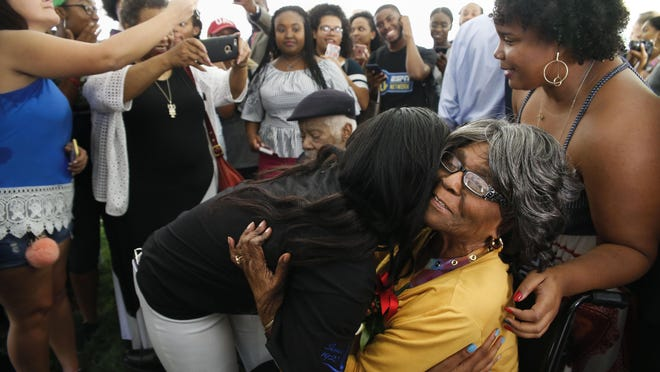 The University of Alabama unveiled a historic marker honoring Autherine Lucy Foster, the first black student admitted to an all-white college in Alabama September 15, 2017. Foster gets a hug from University of Alabama senior Alecea Watkins as students line up to meet her.