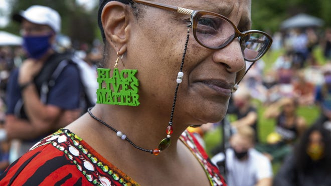 Linda Dixon of Portland attends The Official Juneteenth Celebration Eugene organized by the Blac Eug, Black-Led Action Coalition, at Alton Baker Park in Eugene last Saturday. [Chris Pietsch/The Register-Guard] - registerguard.com