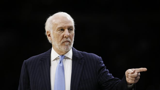 San Antonio Spurs coach Gregg Popovich points to his bench during the first half of a Nov. 22 game against the Philadelphia 76ers in Philadelphia.