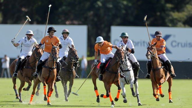 McKenzie Weisz leads the pack for Las Monjitas during Sunday's win over La Indiana in the C.V. Whitney Cup at International Polo Club Palm Beach.