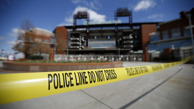 Police tape blocks an entrance to Citizens Bank Park, home of the Philadelphia Phillies baseball team, March 24, in Philadelphia.