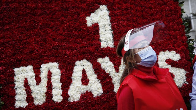 A demonstrator, wearing a face mask and shield for protection against coronavirus, stands during May Day protests in Istanbul, Friday, May 1, 2020. Police in Istanbul detained several demonstrators who tried to march toward Istanbul's symbolic Taksim Square in defiance of the lockdown imposed by the government due to the coronavirus outbreak.