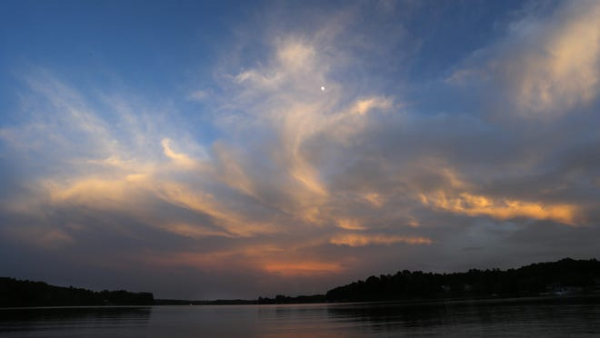 The sunset colors clouds above Lake Tuscaloosa at the boat ramp located on U.S. Highway 43 North Tuesday, June 30, 2020.