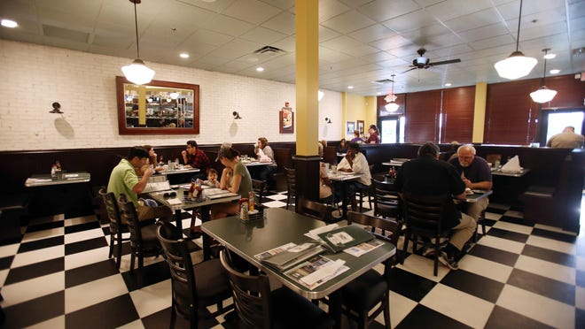 Guests dine at Metro Diner, located next door to Panera in Midtown Village in Tuscaloosa Thursday, April 13, 2017. Following health guidelines for COVID-19, the Metro Diner has re-arranged its interior, and added new sanitation, PPE and distancing procedures, in order to re-open.