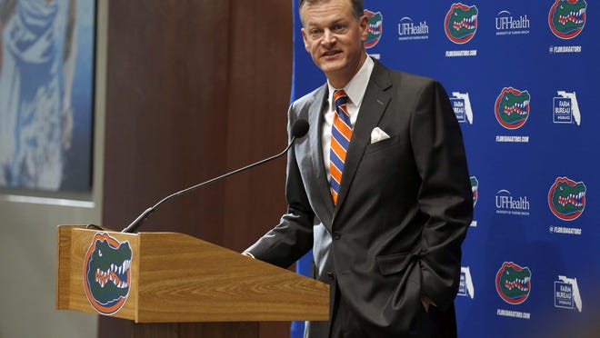 "Florida athletic director Scott Stricklin, shown in a 2017 photo, said, ""We are waiting to see if we can play a game before we worry about what the schedule looks like."""