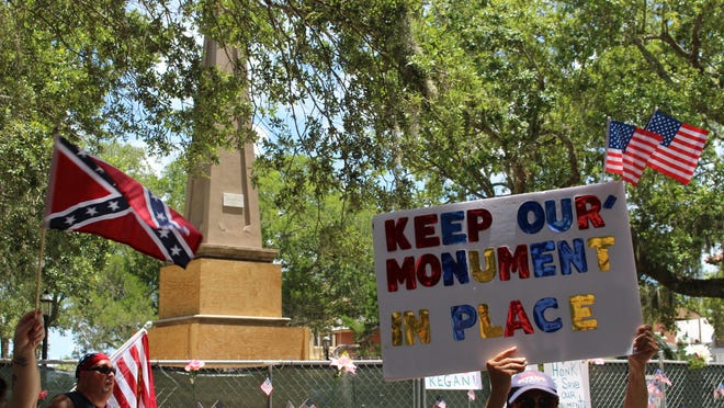 People gather in the Plaza de la Constitución on Saturday, July 18 to protest the removal of the city's Confederate soldier memorial.