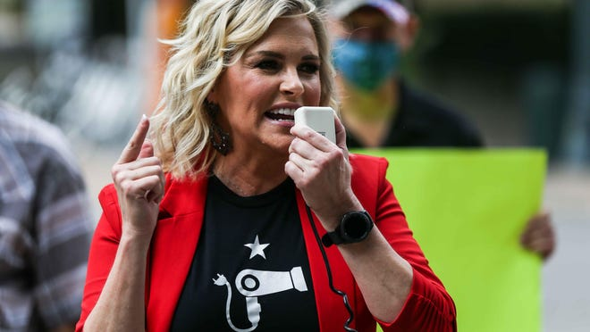 Shelley Luther, a Dallas salon owner who defied an order to keep her business closed, speaks during a Capitol protest June 30 against Gov. Greg Abbott's move to shut down bars.